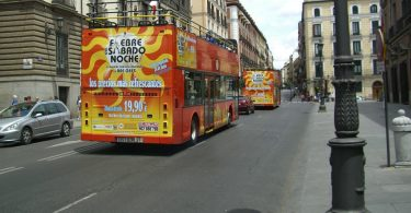 red, double decker tour bus in madrid