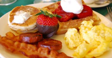 brunch with bacon, eggs, waffles