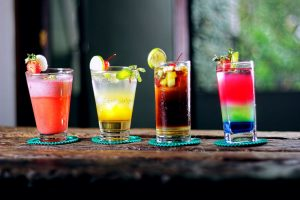 4 colourful drinks on the bar
