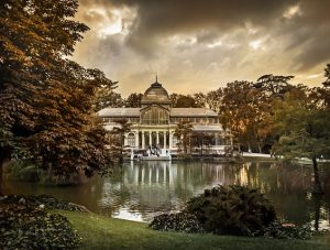 lake at buen retiro park in madrid with clouds