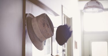 vintage hat and mirror in hallway