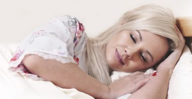 blond woman sleeping in bed