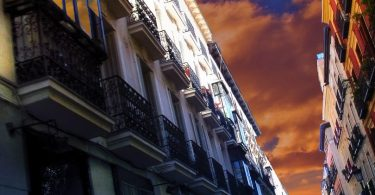 buildings in chueca with red sky