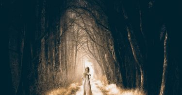 girl in dark forest