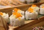 sushi with fish roe on wooden plate
