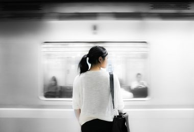 back of asian woman in train station