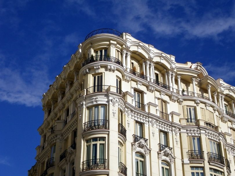 spanish building, light coloured with small balconies