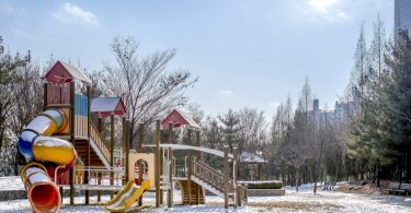 playground in a bit of snow