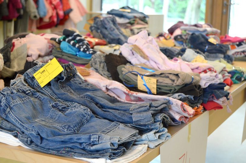 piles of second-hand clothes laid