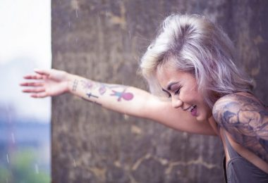 happy lady with tattoo on lower arm