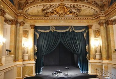 old theatre interior with blue curtain