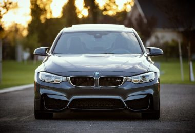 front of grey bmw
