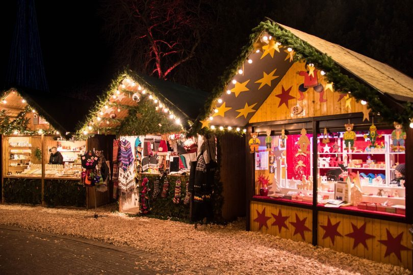 Christmas market stalls in dark