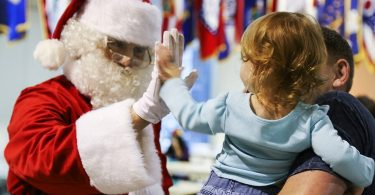 santa claus high fives child