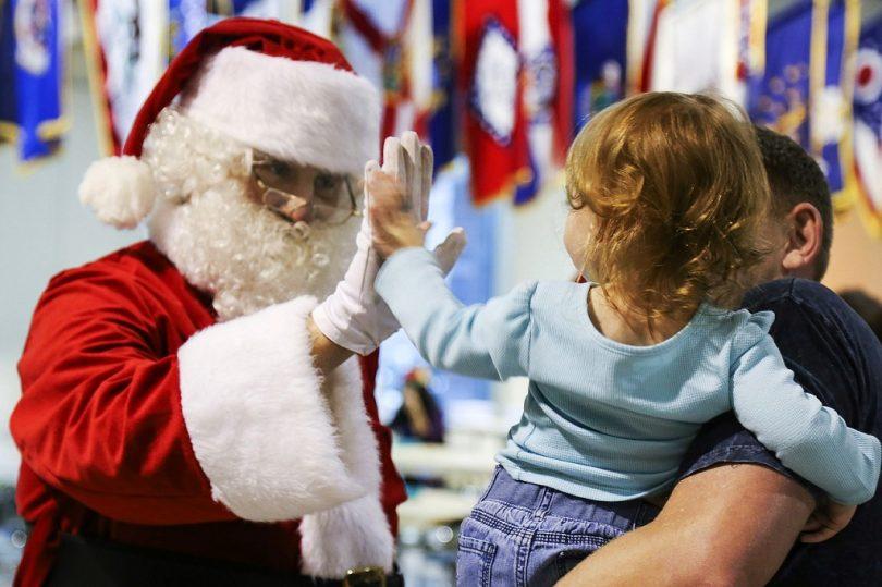 santa claus high fives child