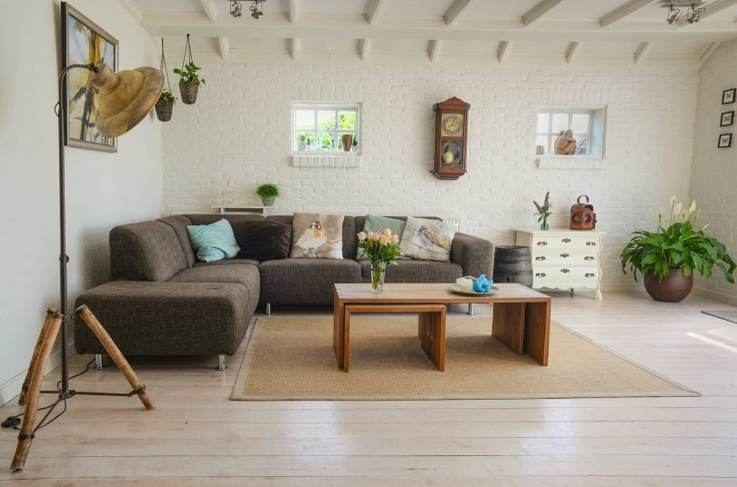 living room with brown couch and wooden tables
