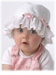 baby in pink with hat