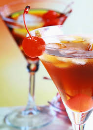 two vermouth cocktails with cherry