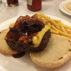 hamburger on a bun with cheese and bacon