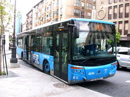 blue bus on streets in madrid