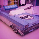 interior Tommy Mel's with cardboard retro car