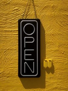 'open'sign with yellow background