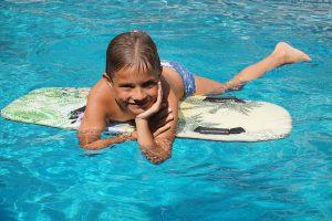 boy on surfboard in water