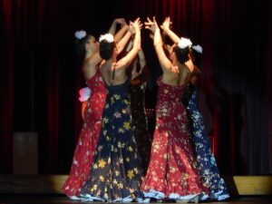 four colourful female flamenco dancers