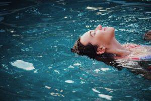 woman lying on back in water