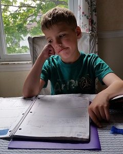 young boy unhappy with his homework