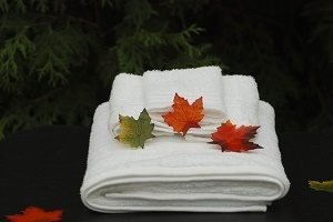 autumn leaves on spa towels