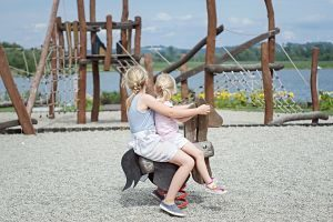 playground with two sisters playing