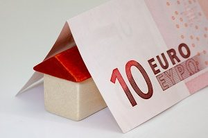 toy house with 10 euro note folded over it