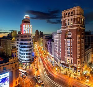 gran via in madrid in dark with lights from traffic