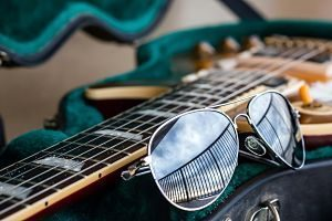 close up of guitar and sunglasses