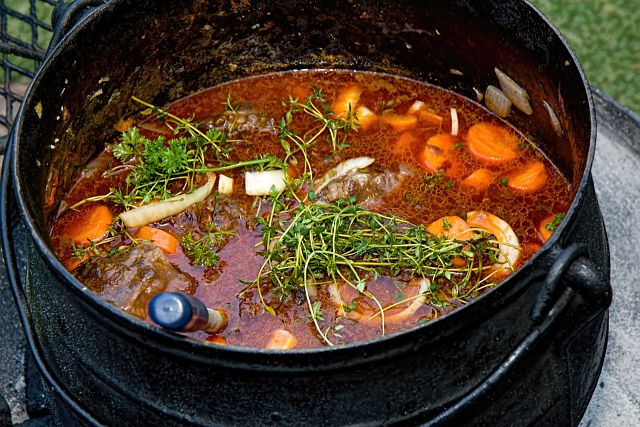 large pan with stew and herbs