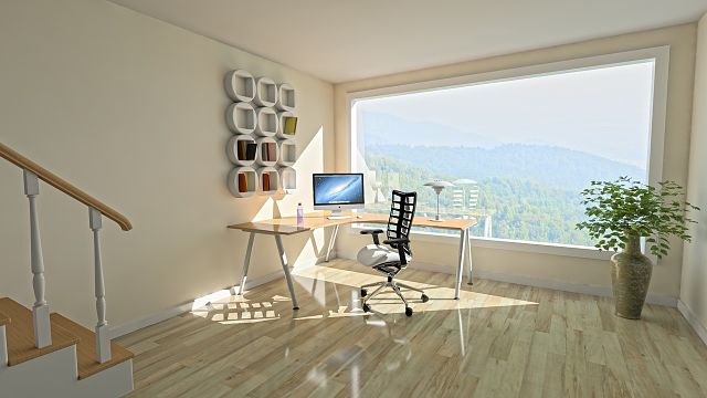 desk in front of large window
